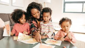 African-American mom talking with her kids about their drawings.